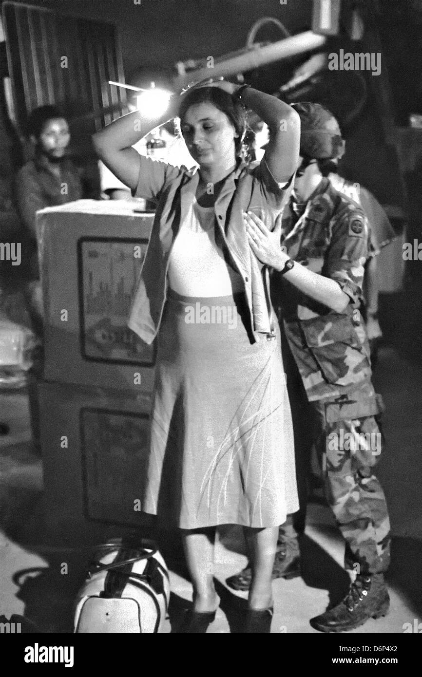 A woman soldier with the 82nd Airborne Division searches a Cuban national at the US Joint Detention Center Cuba - Stock Image