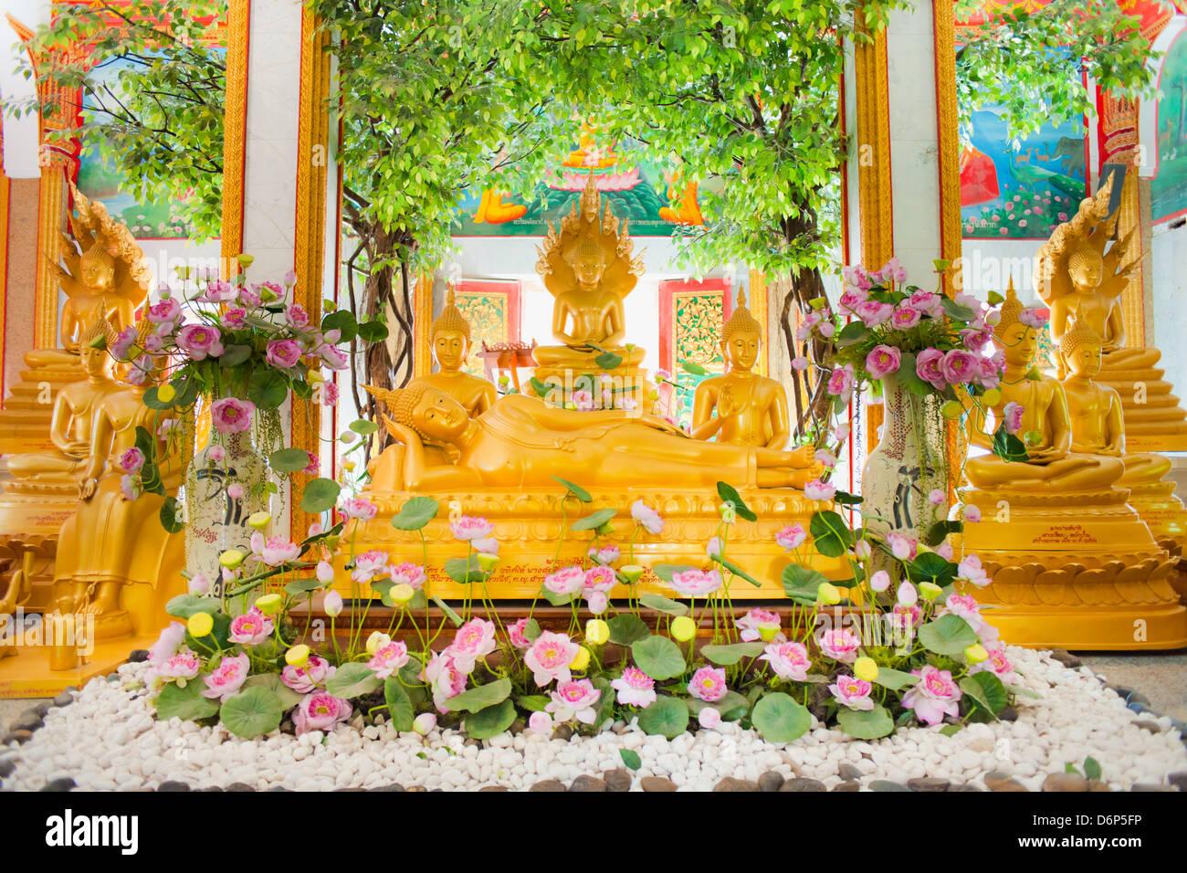 Reclining Buddha and other statues, Karon Beach, Buddhist Temple, Phuket Island, Phuket, Thailand, Southeast Asia, - Stock Image