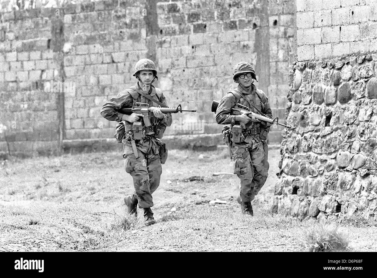 US Marines armed with M16A1 rifle patrols the area around Grenville during the Invasion of Grenada, codenamed Operation - Stock Image