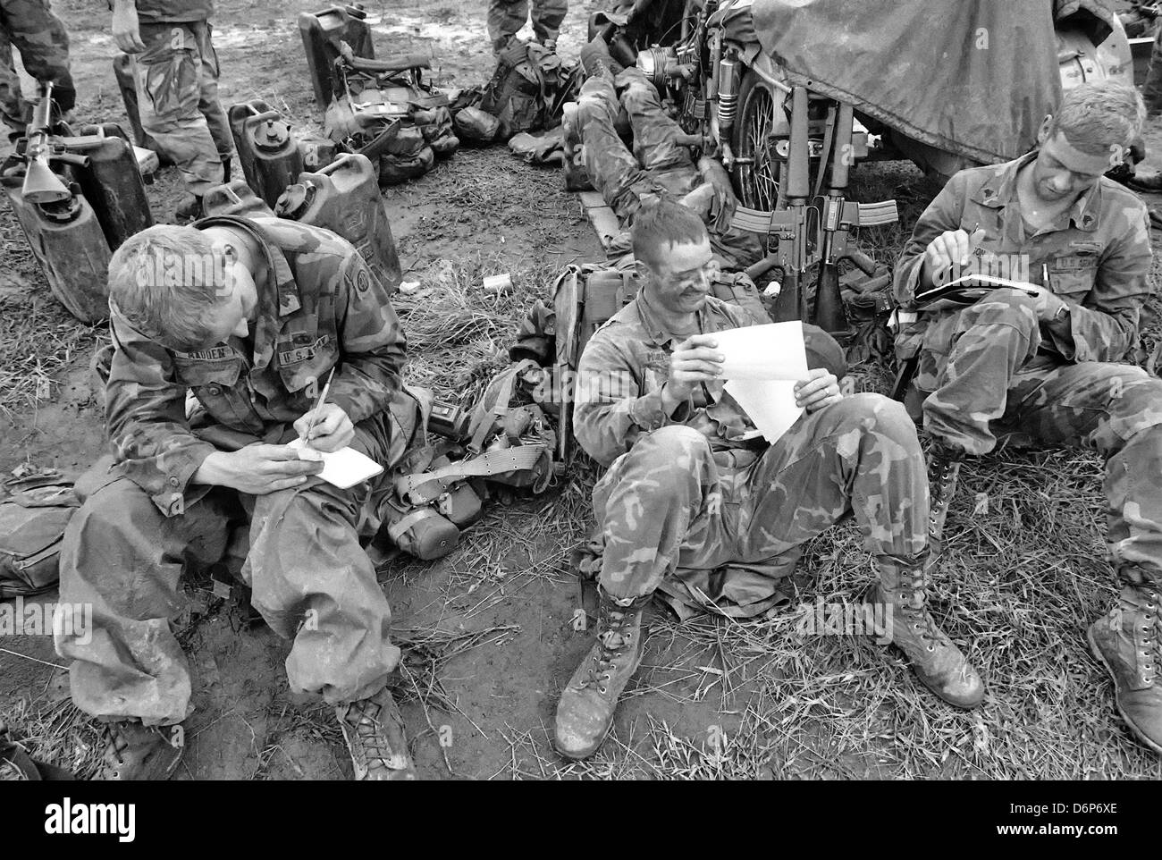 Members of the 82nd Airborne Division write letters while taking a break on a ridge during the Invasion of Grenada, - Stock Image