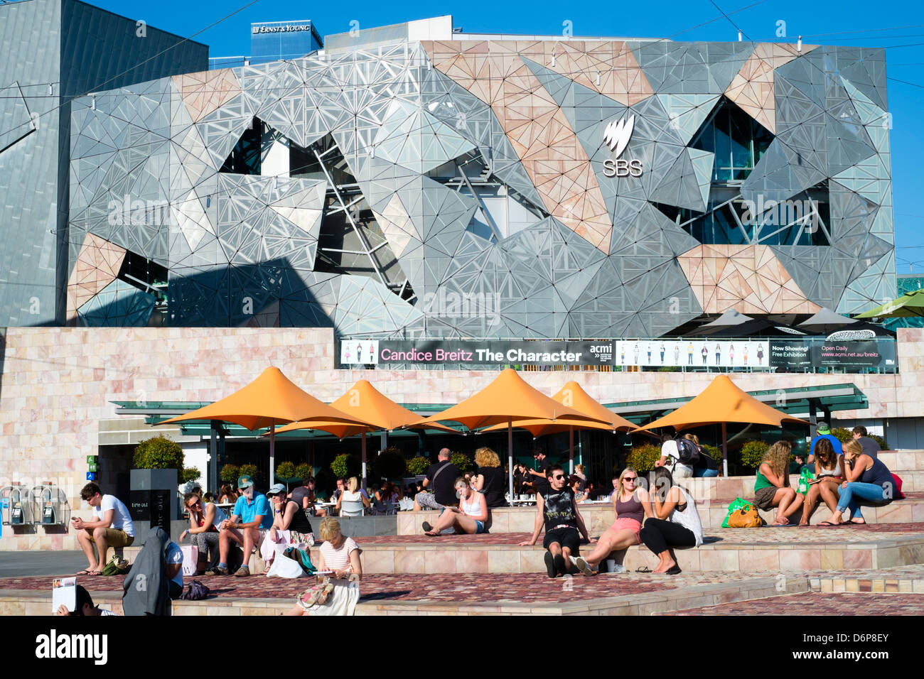 View of bars and people at Federation Square in central Melbourne Australia - Stock Image