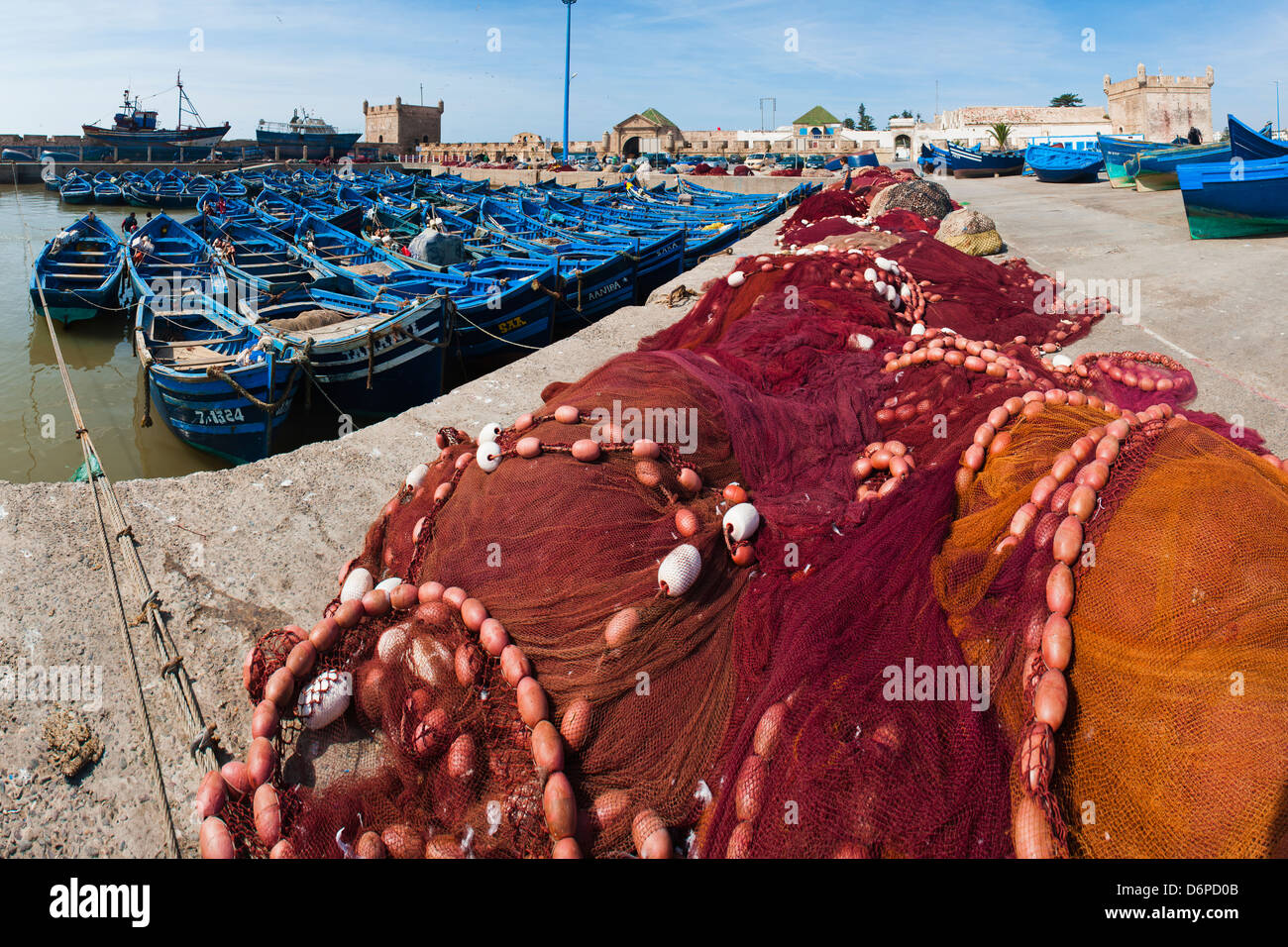 Fishing nets and blue fishing boats in Essaouira Port, formerly Mogador, Morocco, North Africa, Africa - Stock Image
