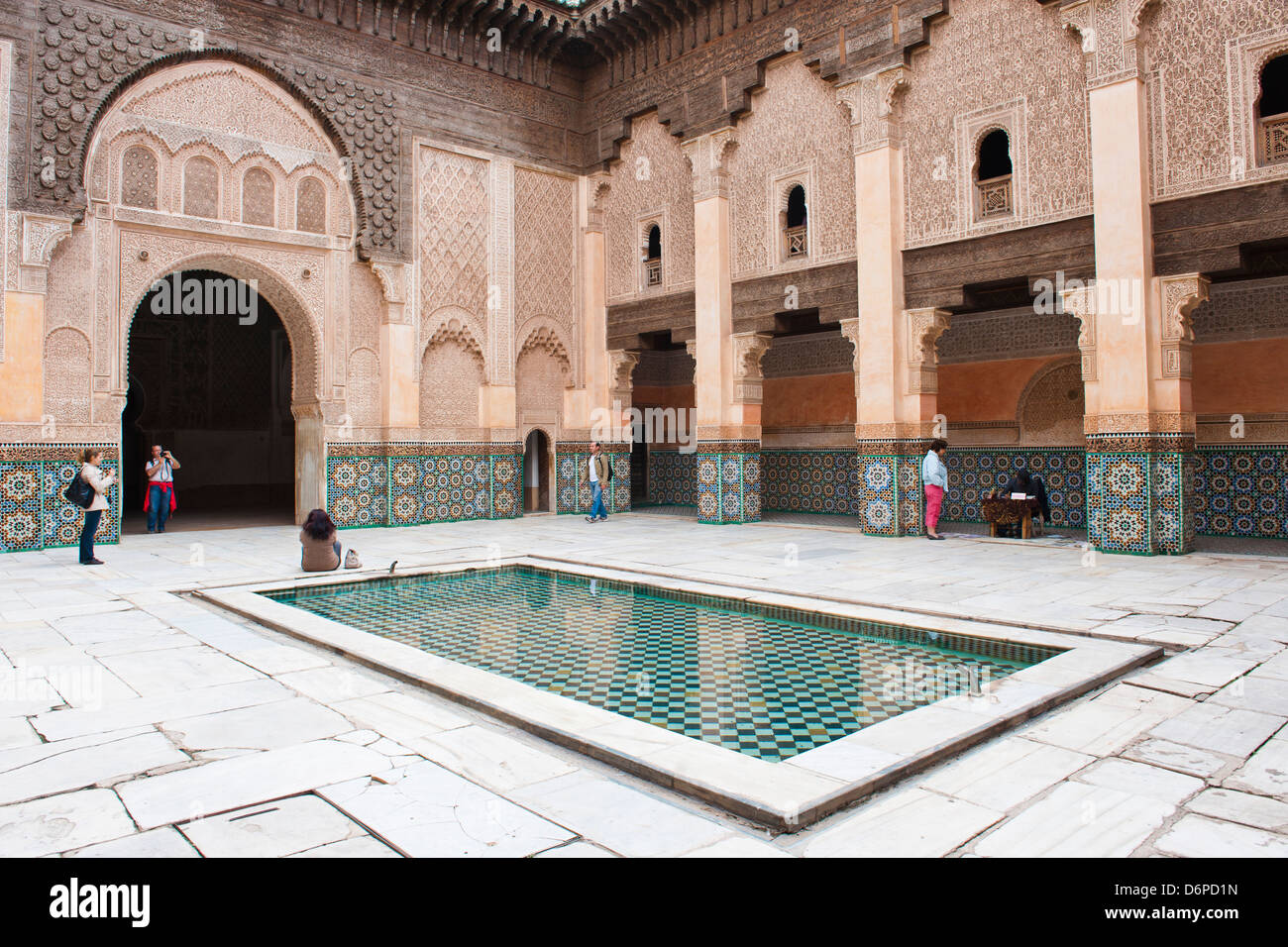 Tourists visiting Medersa Ben Youssef, the old Islamic school, Old Medina, Marrakech, Morocco, North Africa, Africa - Stock Image
