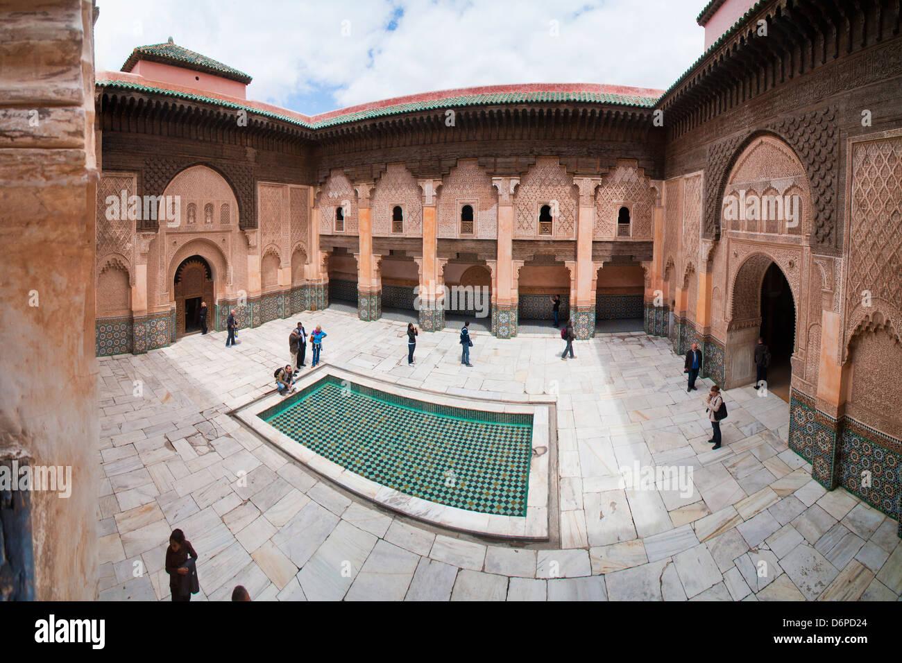 Tourists visiting Medersa Ben Youssef, the old Islamic Koranic school, Old Medina, Marrakech, Morocco, North Africa, - Stock Image