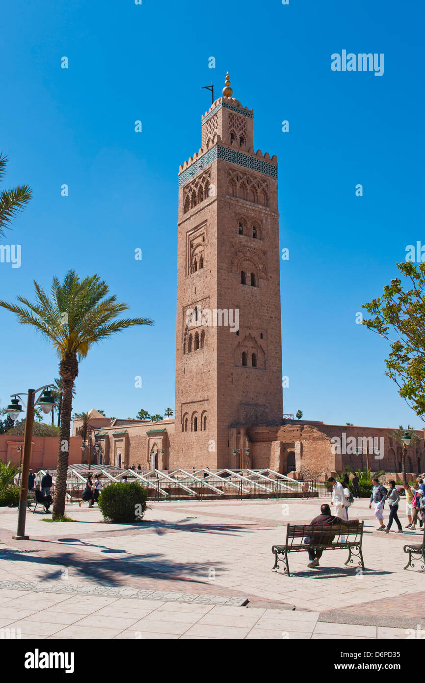 Moroccan man sat on a bench in front of Koutoubia Mosque, Marrakech, Morocco, North Africa, Africa - Stock Image