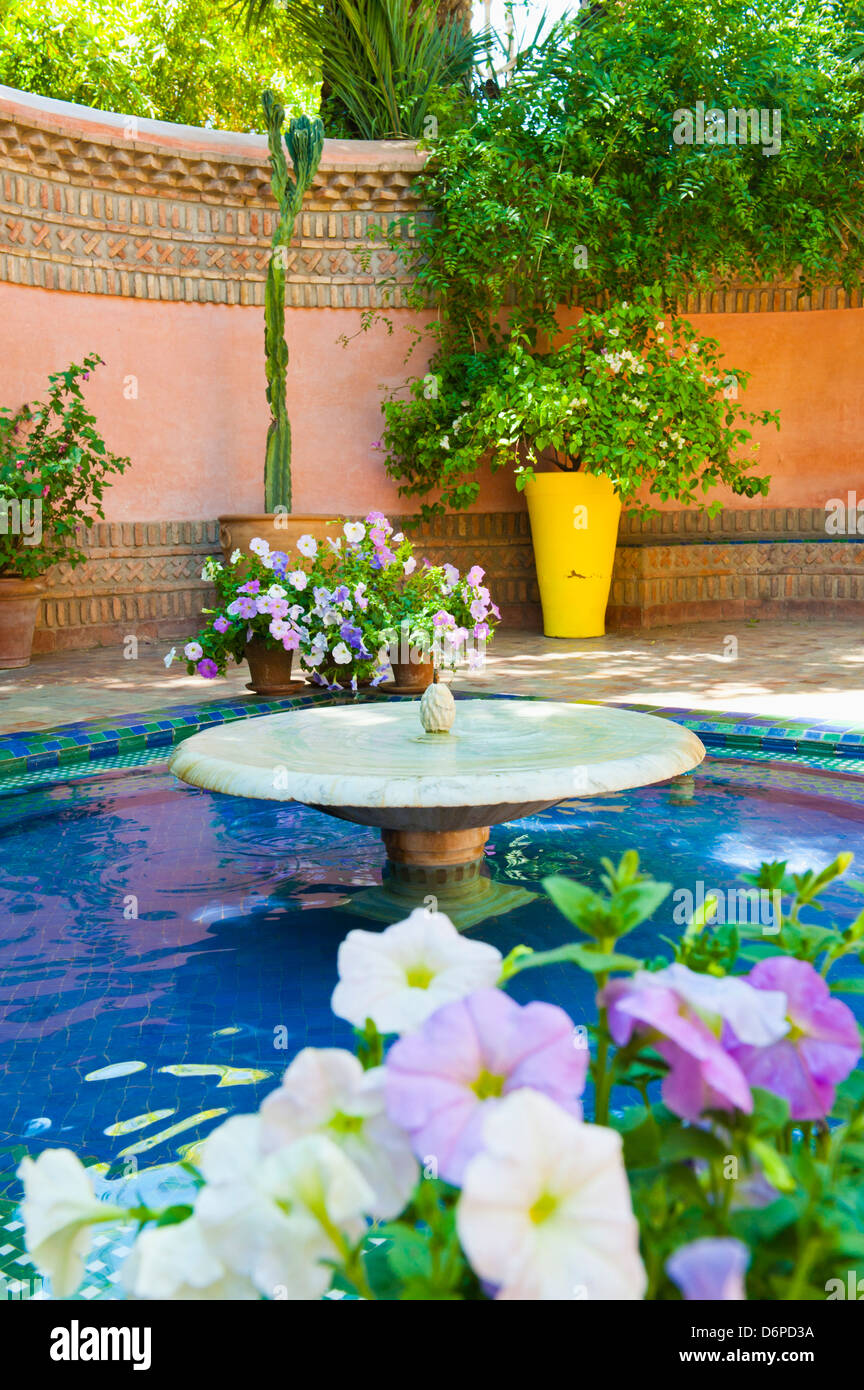 Fountain and flowers in the Majorelle Gardens (Gardens of Yves Saint-Laurent), Marrakech, Morocco, North Africa, - Stock Image