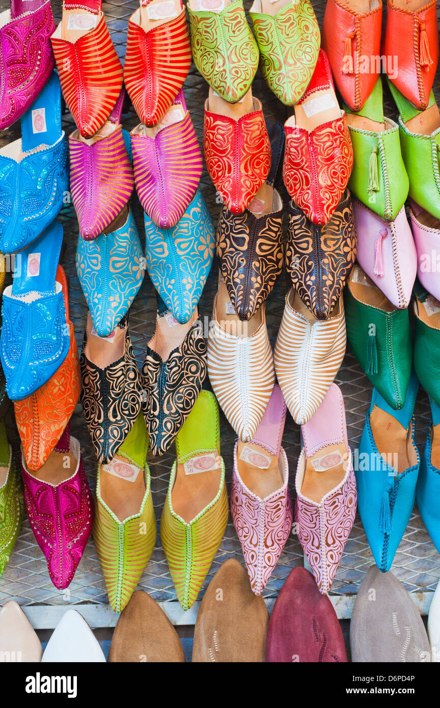 Colourful babouche for sale in thesouks in the old Medina, Place Djemaa El Fna, Marrakech, Morocco, North Africa, - Stock Image