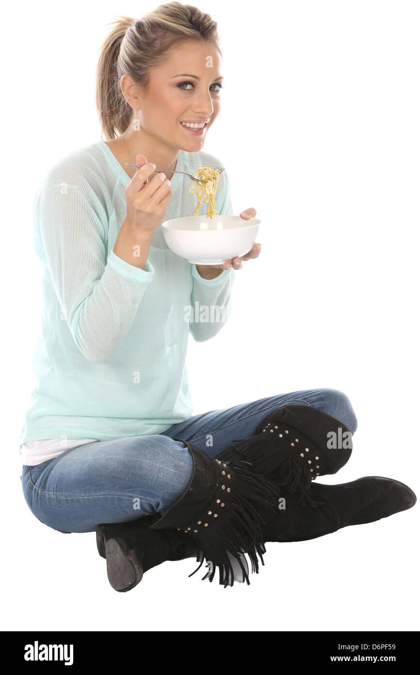 Woman Eating Pot Noodles - Stock Image