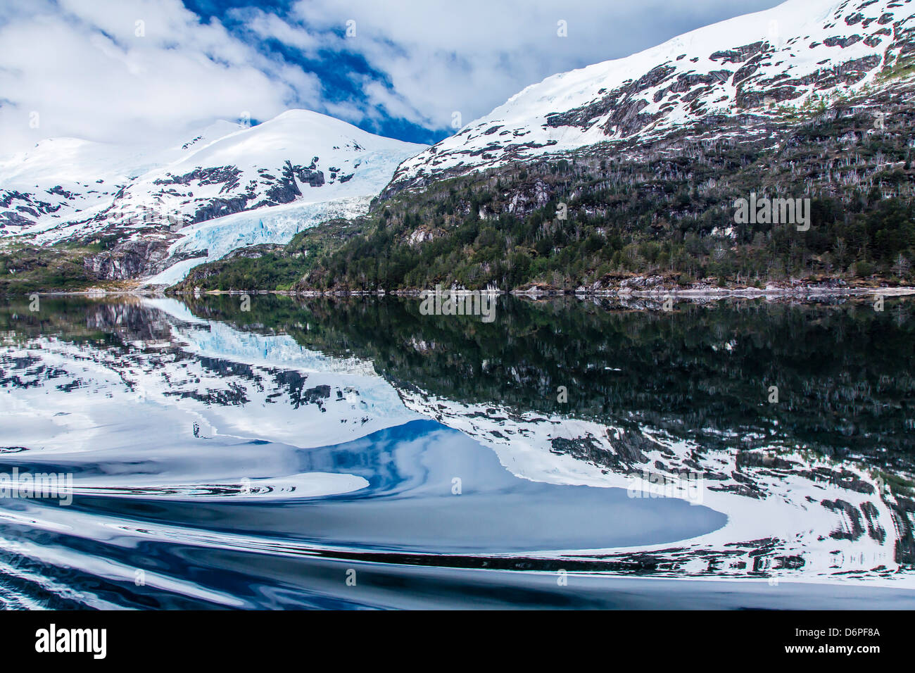 Reflections in calm water in the Strait of Magellan, Patagonia, Chile, South America - Stock Image