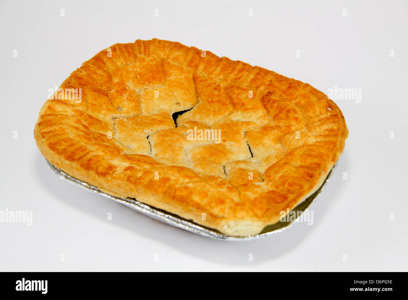 Uncooked shop bought steak pie - Stock Image