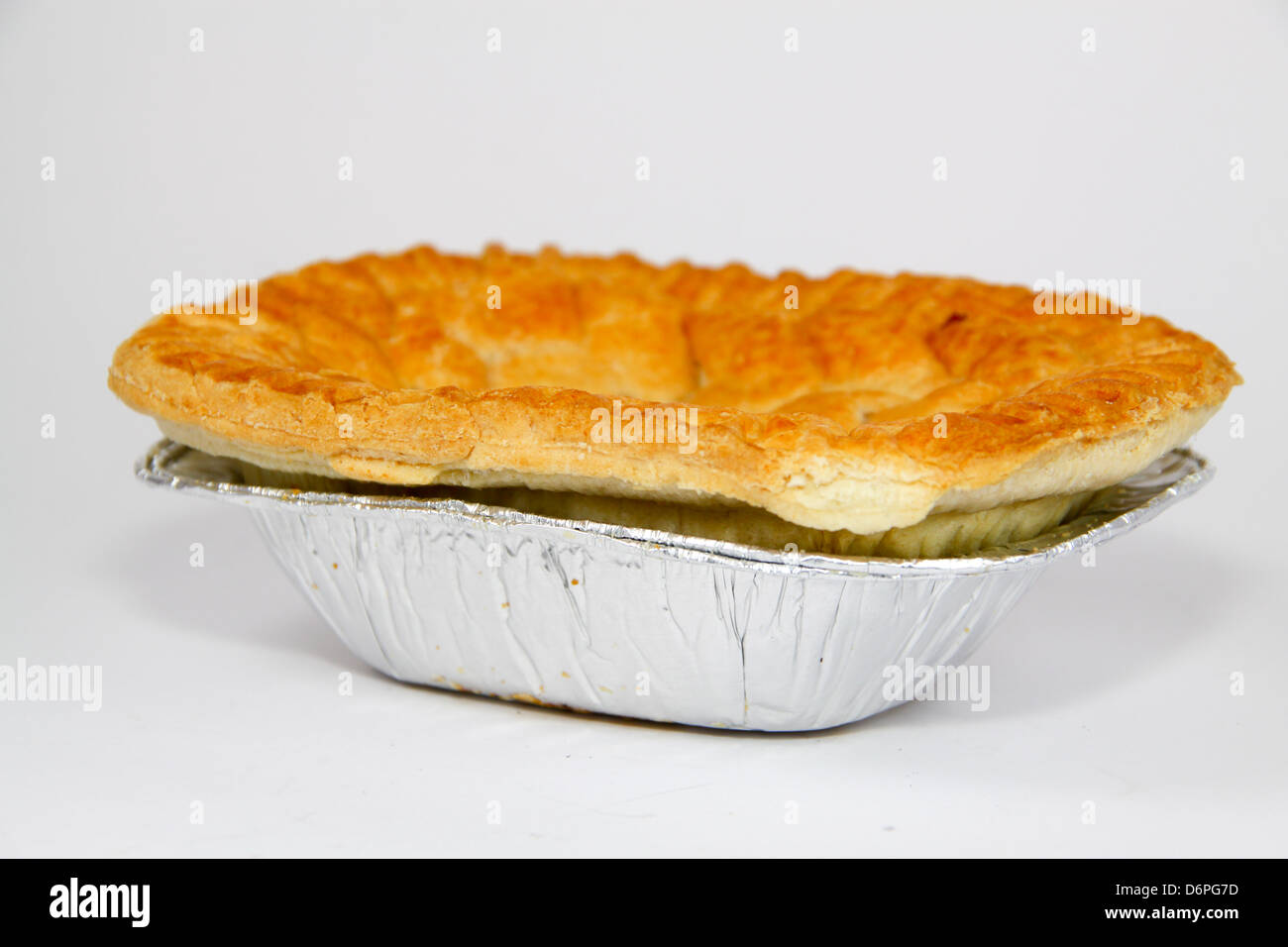 Uncooked shop bought steak pie - Stock Image