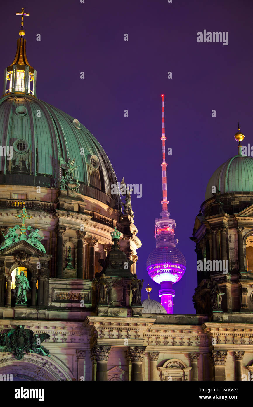 Close-up of the Berliner Dom (Cathedral) with the Television Tower in the background at night, Berlin, Germany, - Stock Image