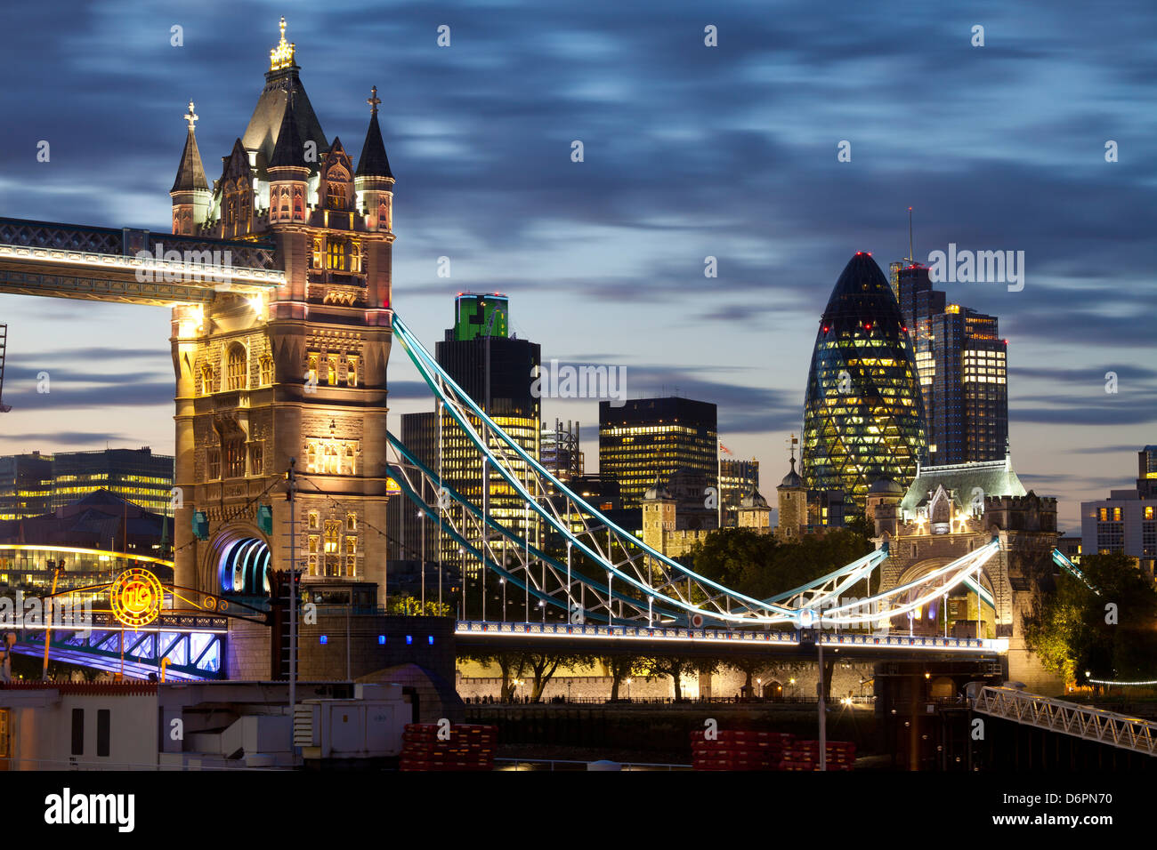 Tower Bridge and the City of London at night, London, England, United Kingdom, Europe - Stock Image