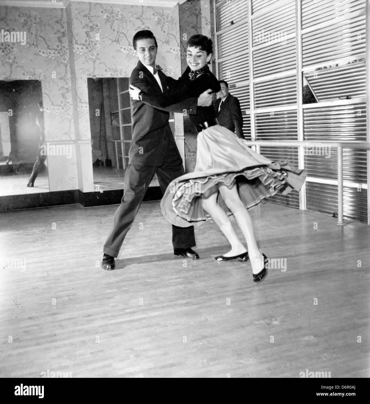 Audrey Hepburn and dancing partner by Earl Theisen, 1954 - Stock Image