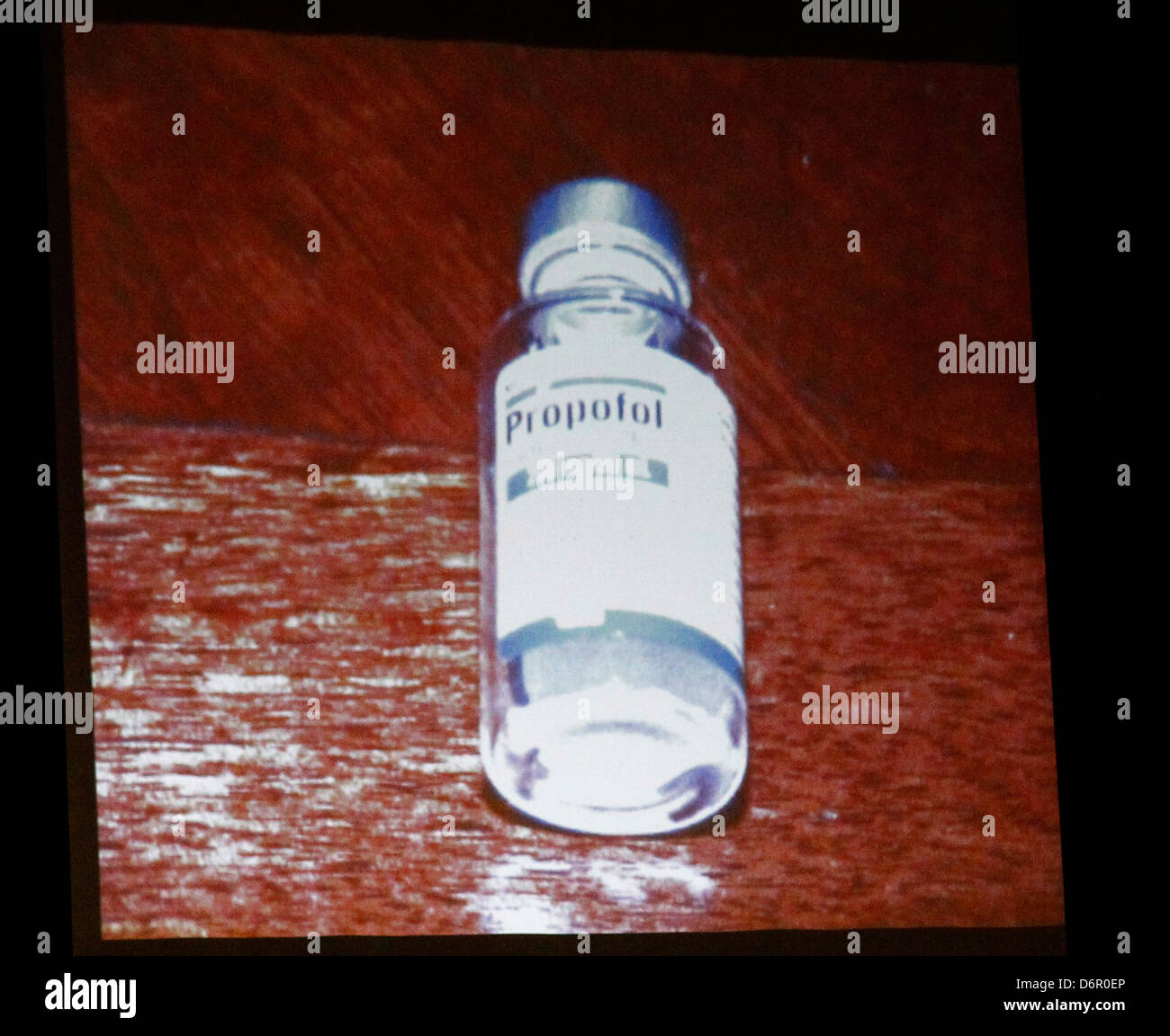 A bottle of propofol lies under a side table found in the bedroom of pop star Michael Jackson in this photo projected - Stock Image