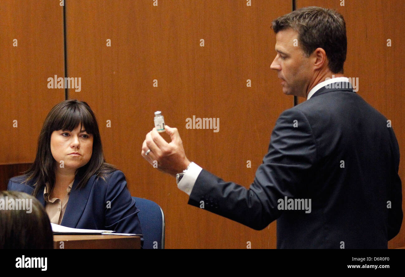 Deputy District Attorney David Walgren holds a bottle of