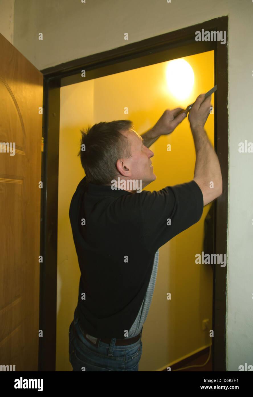 Poznan, Poland, edited a man from Schluesseldienst door frames - Stock Image