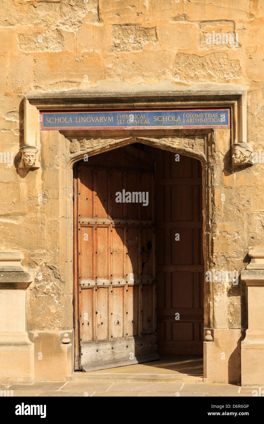 Bodleian Library doorway with studded wooden door in Old Schools Quadrangle in Oxford university Oxfordshire England - Stock Image