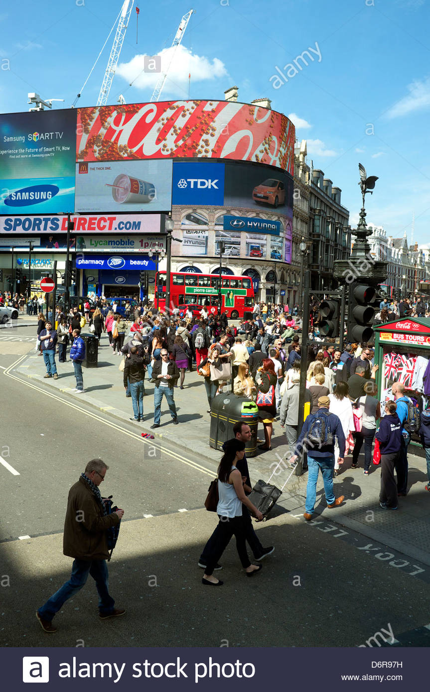 Busy street scene at Piccadilly Circus, with pedestrians in abundance. London, UK, 2013. - Stock Image