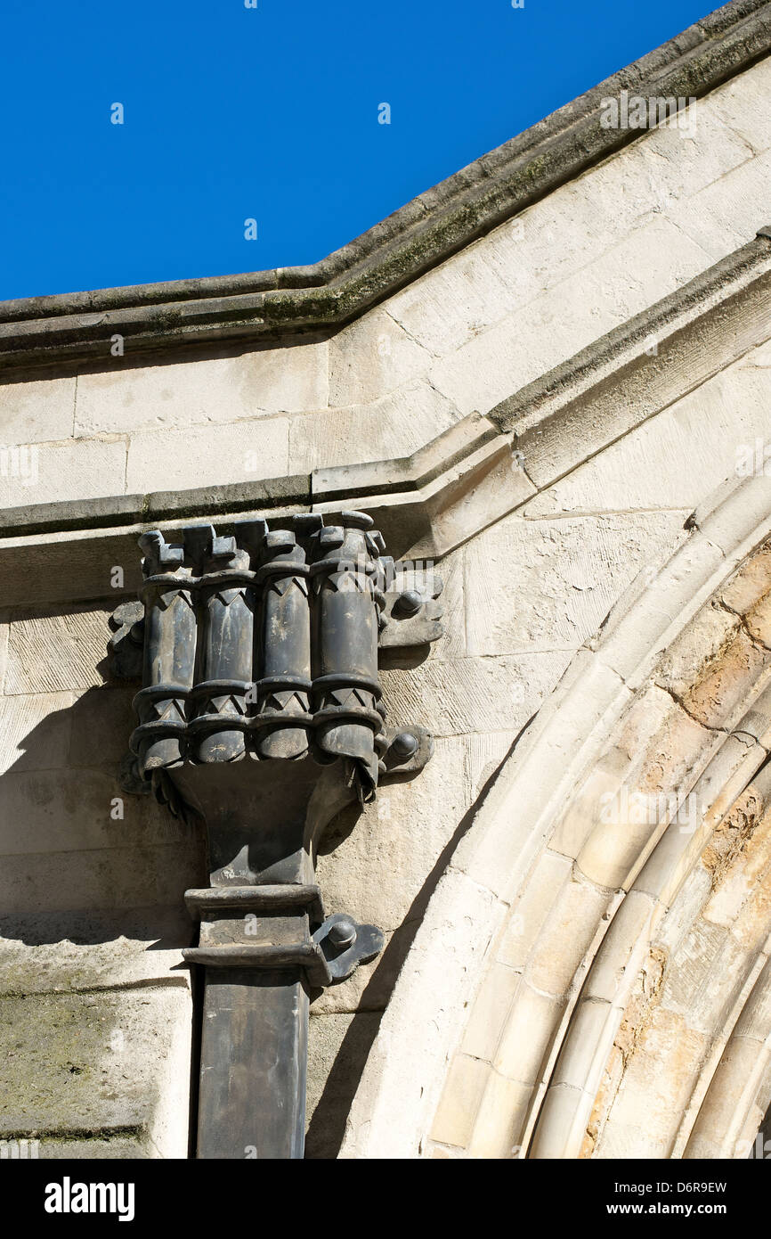 The ornate down gutter pipe Round Tower of the Knights Templars 1185 Gothic Round Church Temple Church in London - Stock Image