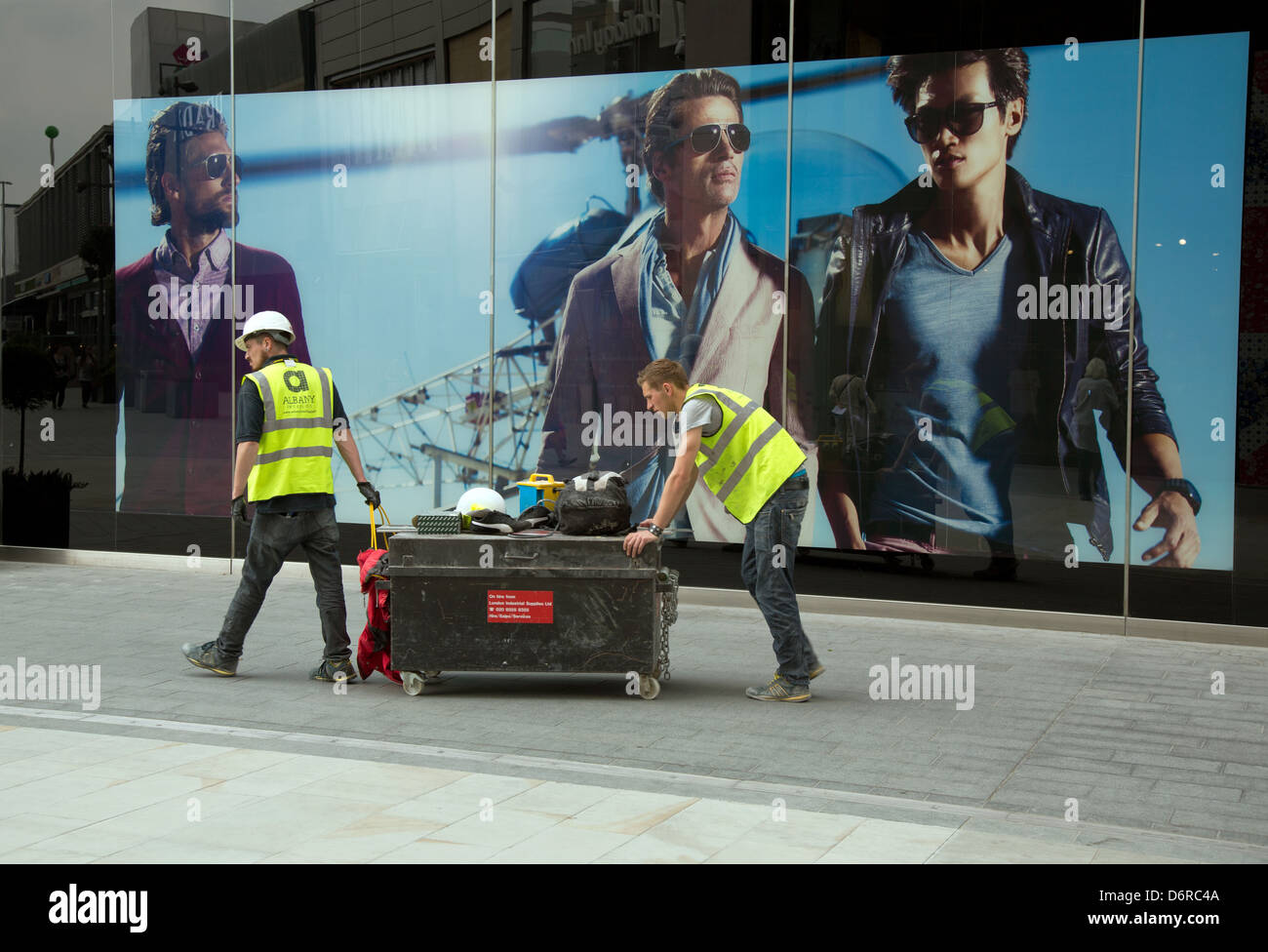 London, United Kingdom, craftsmen from Albany Interiors Ltd before the Boss Store - Stock Image