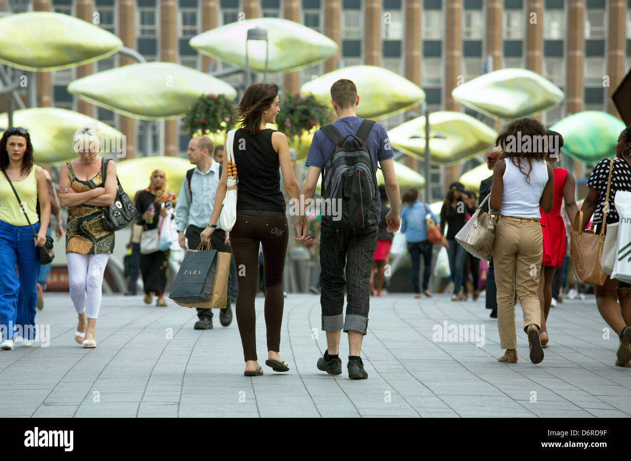 London, UK, passersby on a place in the Stratford district in the East End of London Stock Photo