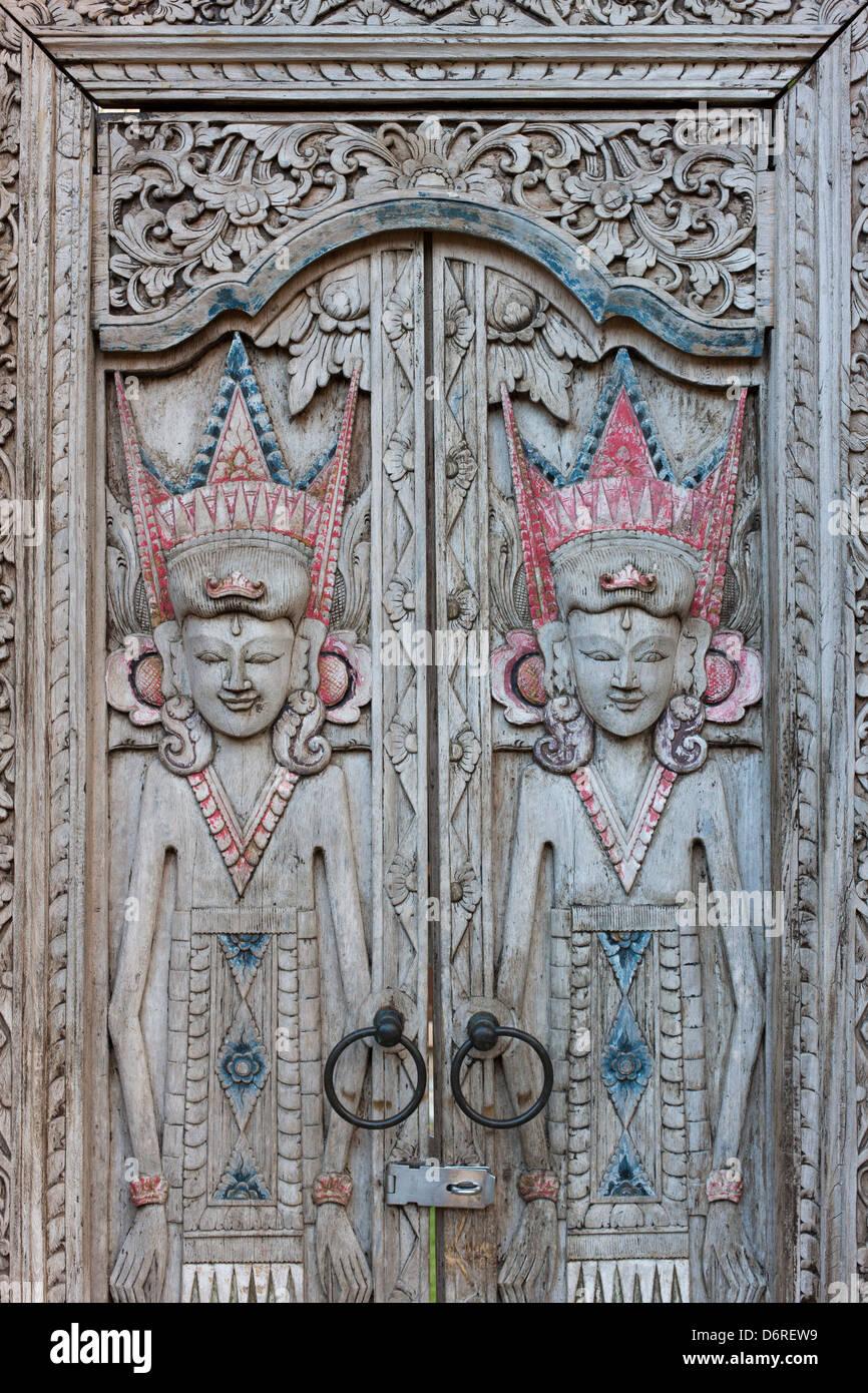 Hand carved wooden doors at the Mimpi Resort Menjangan in Bali, Indonesia - Stock Image
