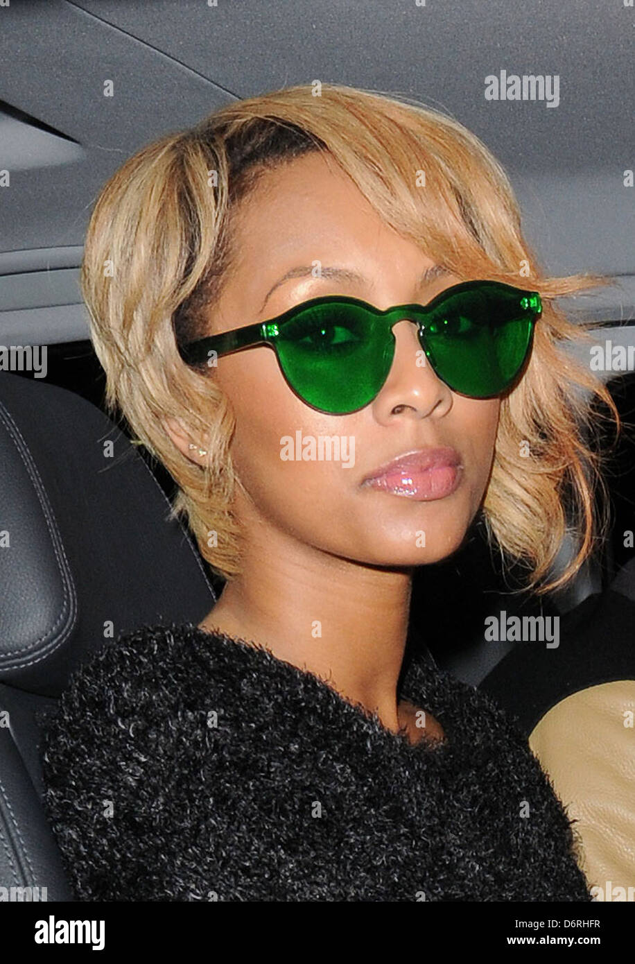3ada8e58e1 Keri Hilson leaving May Fair Hotel wearing green tinted sunglasses. London