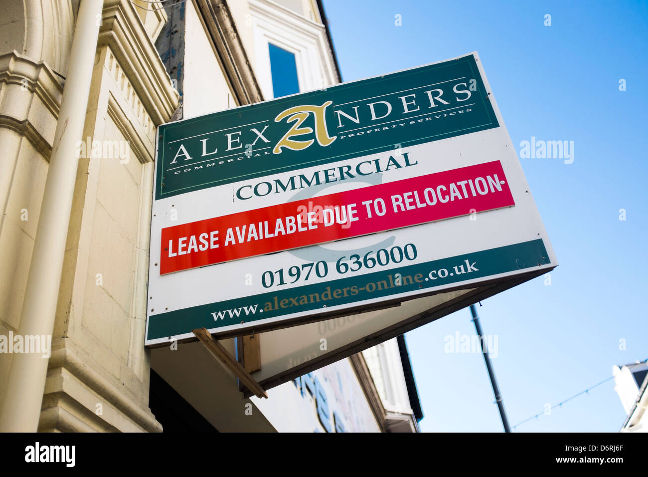 Commercial shop lease available due to relocation - estate agents sign above retail store, UK - Stock Image