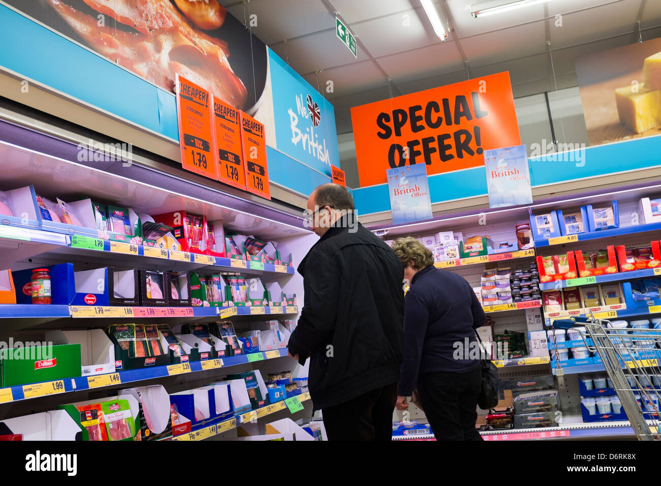 A couple man woman buying food in a branch of Lidl discount supermarket UK Stock Photo