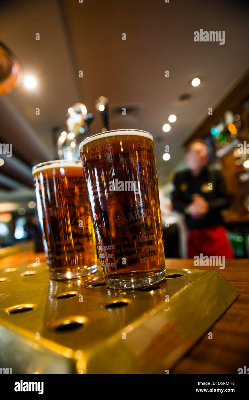 Two pints of draught beer real ale, on the bar in a Marstons pub UK Stock Photo
