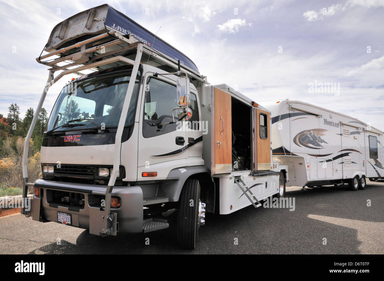 Rv Rig Including A Large Tow Vehicle Carrying A Boat On