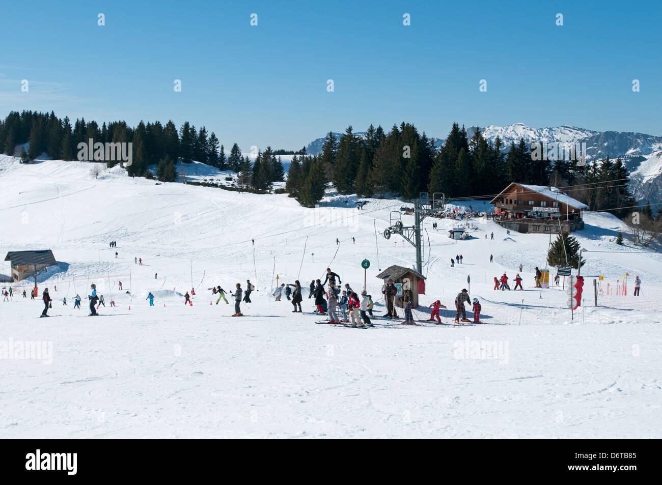 Kids at ski school Beauregard green run La Clusaz French alps - Stock Image