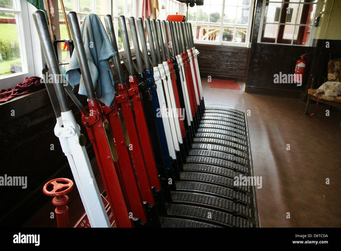 Railway signal box with actuating levers for controlling signals and points at the Bala Lake Railway in Llanuwchllyn - Stock Image