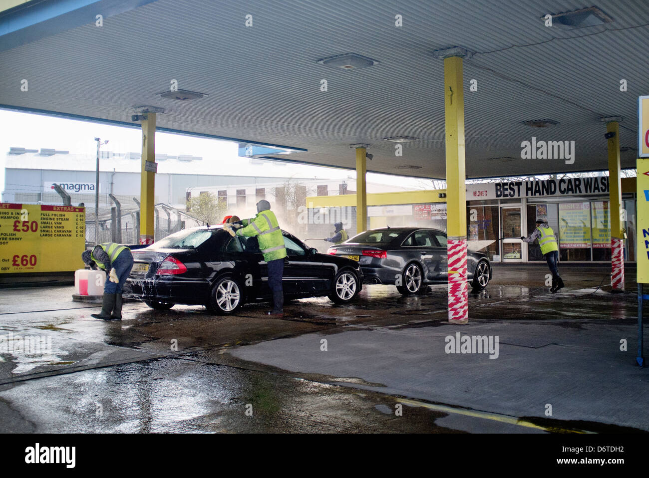 drive thru hand car wash and valet - Stock Image