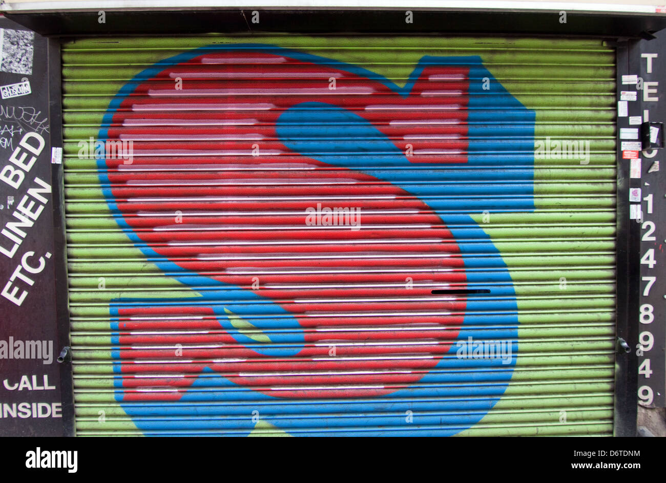 The letter S by streetartist and printer Ben Eine on a shopo shutter in London - Stock Image