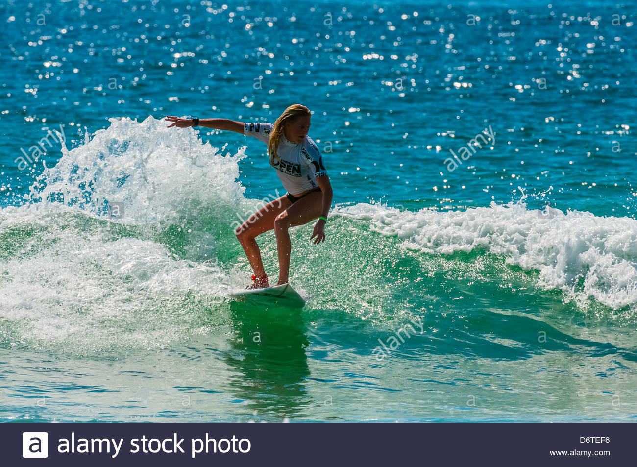 Female pro surfer competing in the finals of the Australian Open of Surfing, Manly Beach, Sydney, New South Wales, Stock Photo