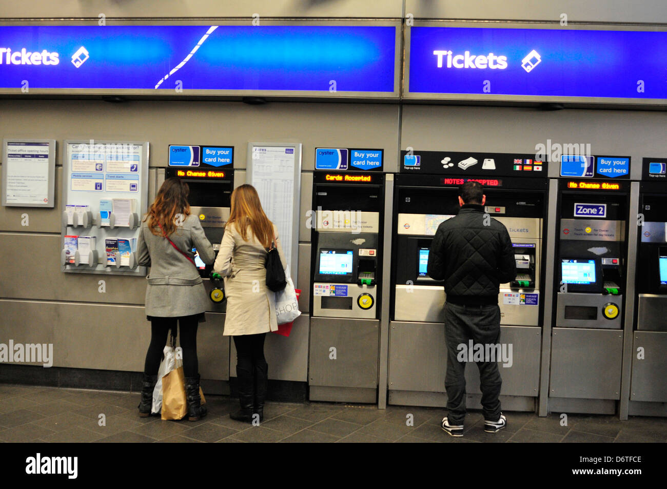 Commuters buy ticket at an Underground station in London, UK. Stock Photo