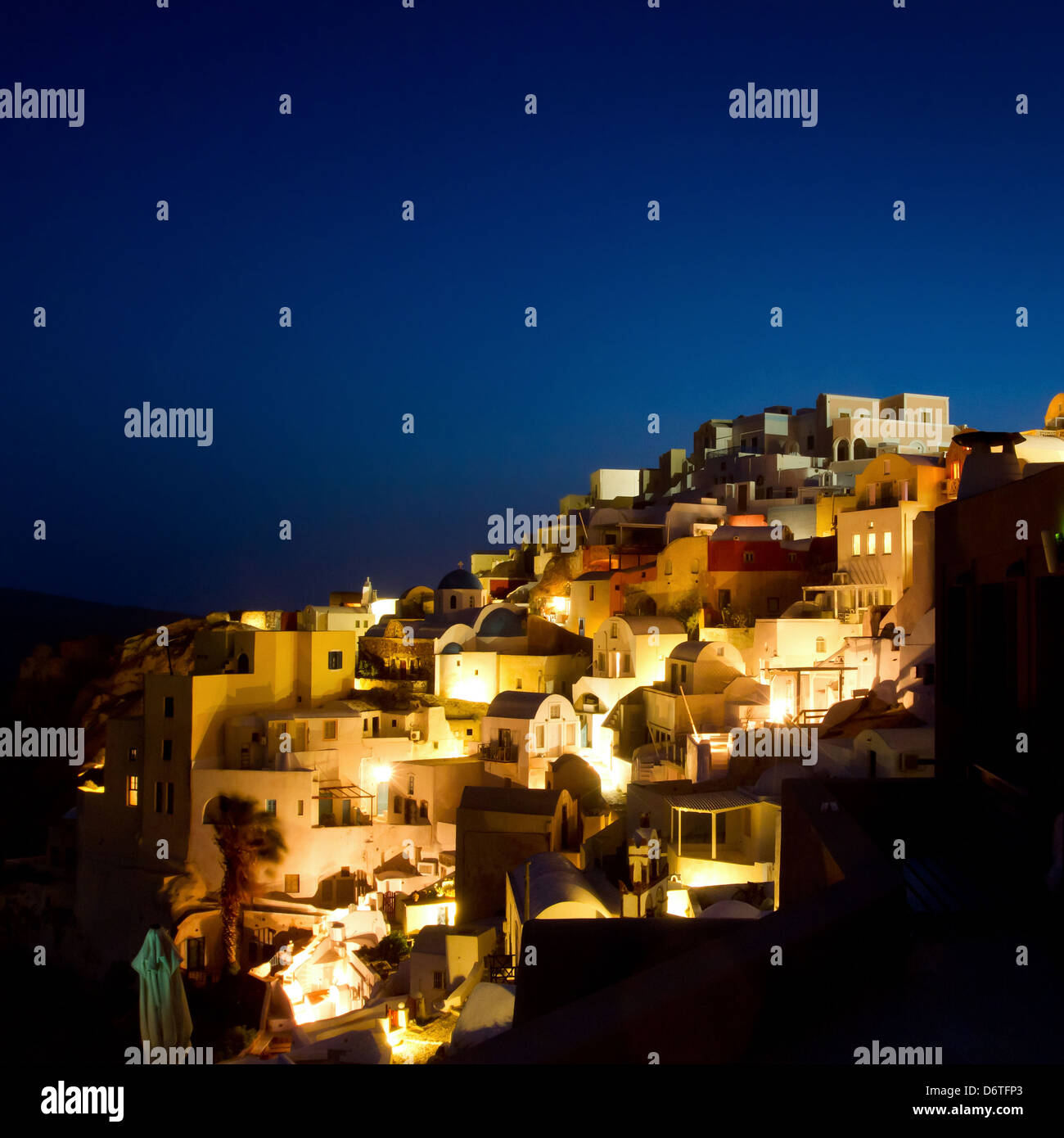 beautiful night lights of Oia village, Santorini view, Greece - Stock Image
