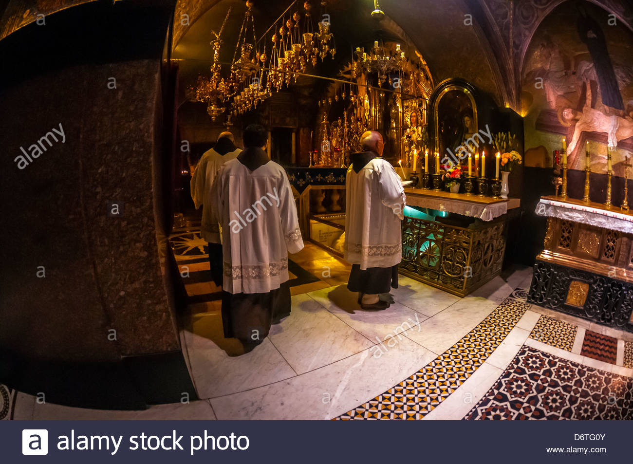 A Roman Catholic Mass in the Church of the Holy Sepulchre (site of the last five stations of the Cross and venerated - Stock Image