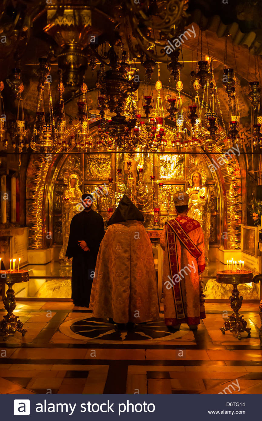 An Armenian orthodox mass at the in the Altar of the Crucifixion in the Church of the Holy Sepulchre (site of the Stock Photo
