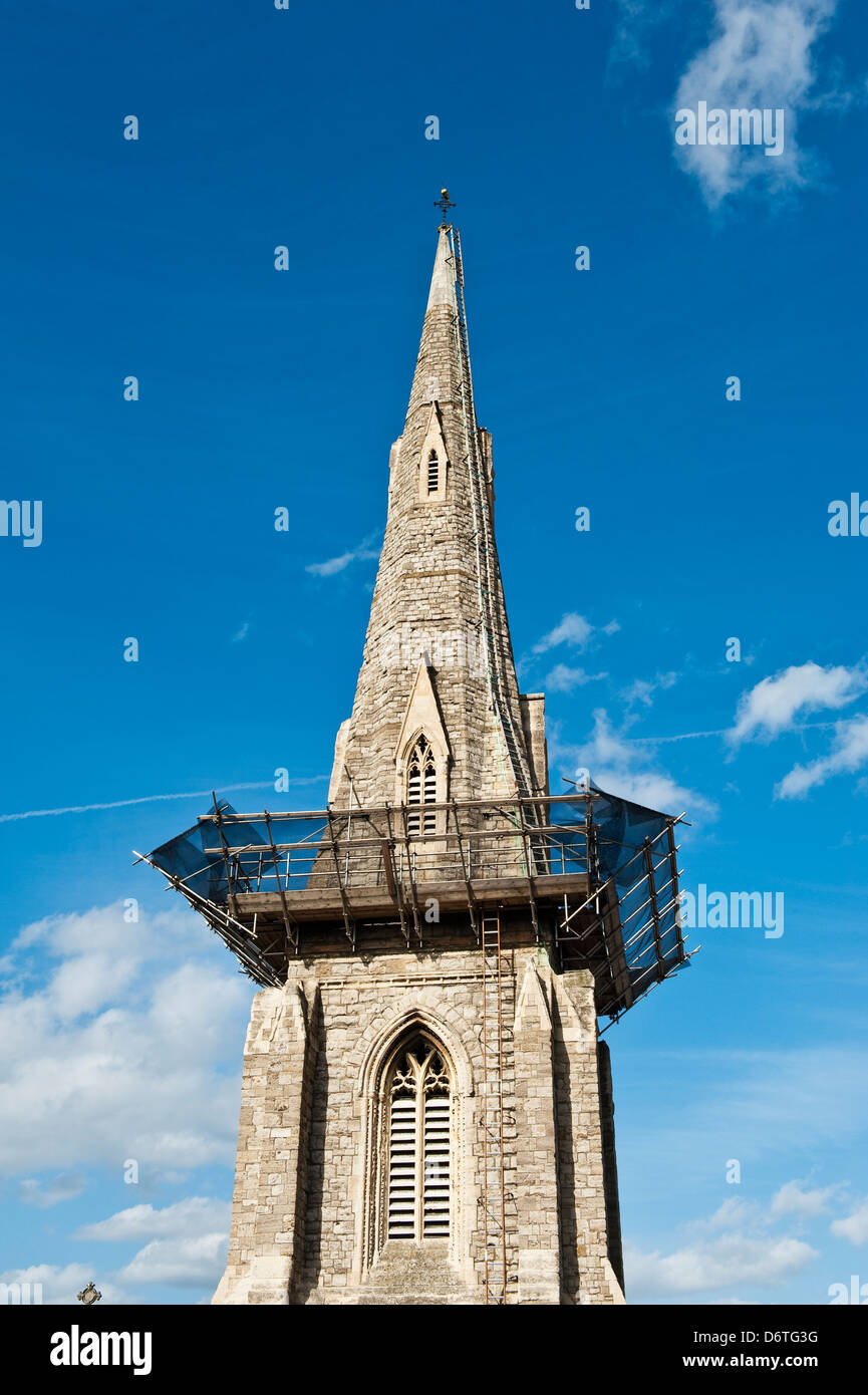 The spire of St Mary's Church, Clapham, London, UK. Protective netting and scaffolding to catch falling stonework - Stock Image
