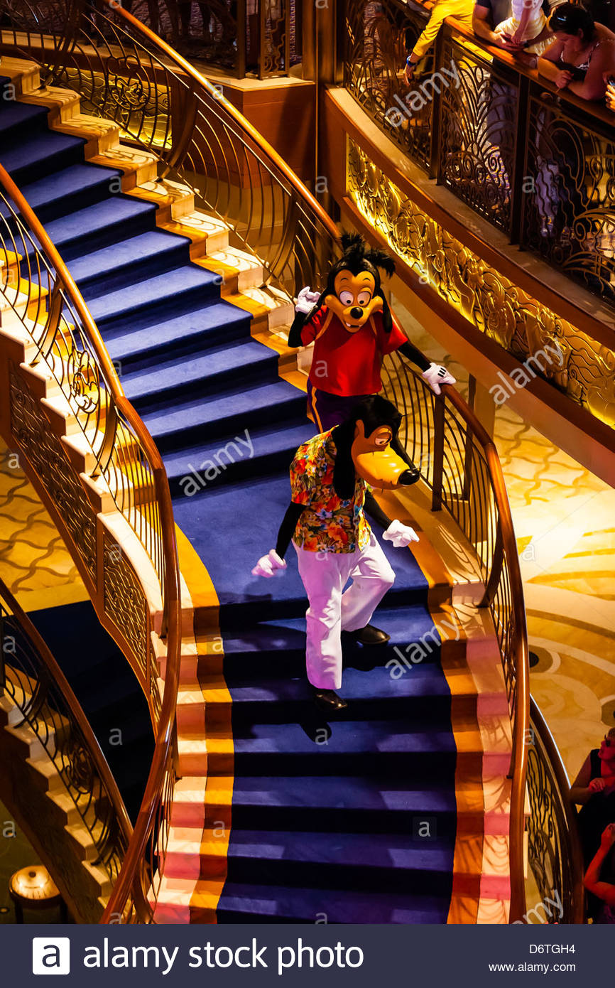 Goofy and Max Goof, Character dance party, in the lobby atrium on the new Disney Dream cruise ship sailing between - Stock Image