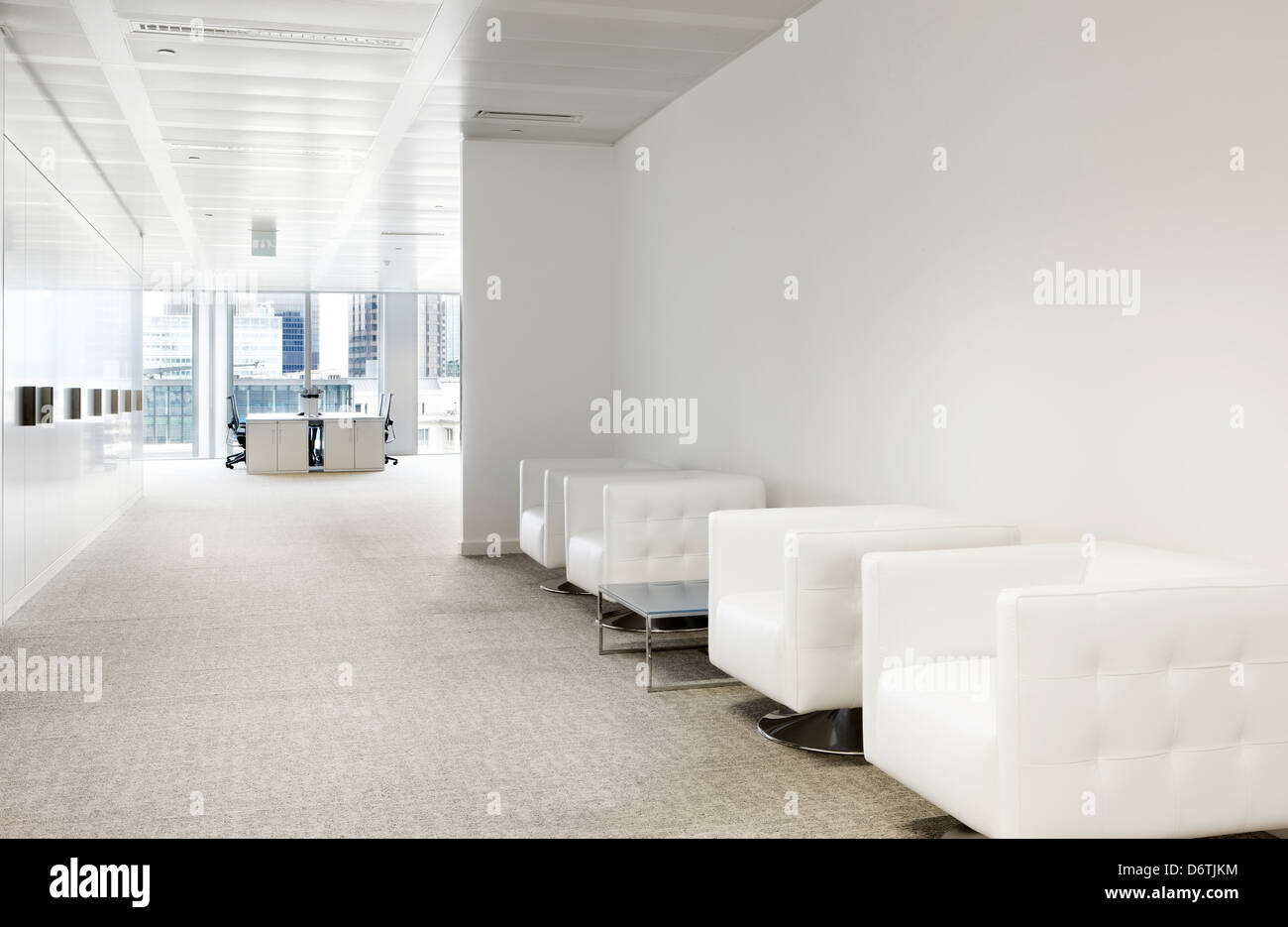 white cube leather seats upholstered waiting room - Stock Image