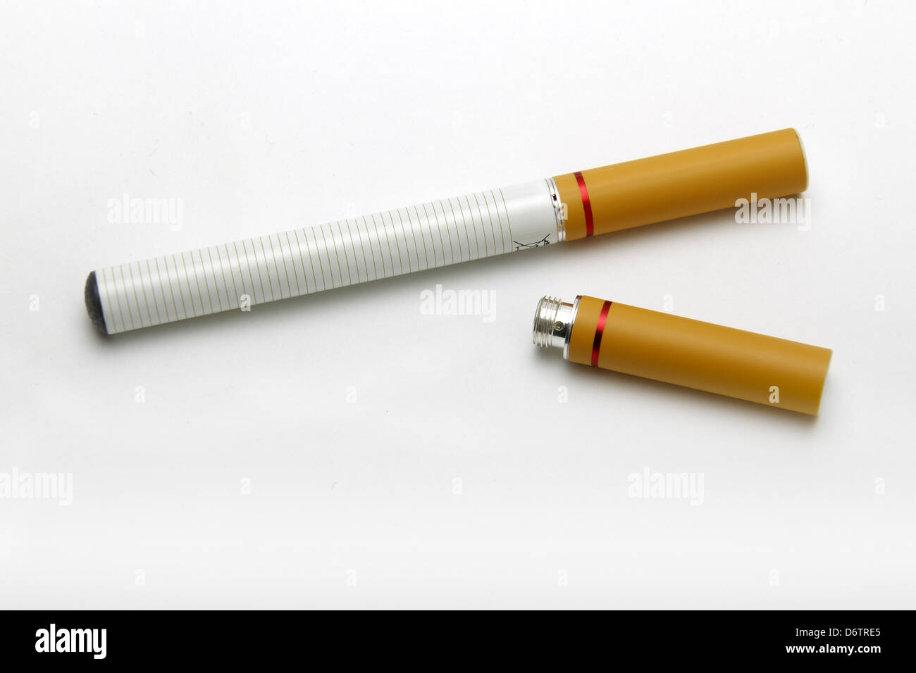 Electronic cigarette and spare nicotine cartridge. - Stock Image