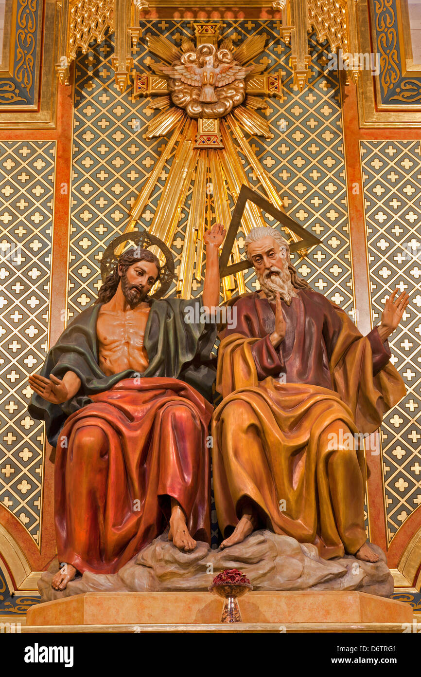 MADRID - MARCH 10: Statue of Holy Trinity from side altar of Almudena cathedral on March 10, 2013 in Spain. - Stock Image