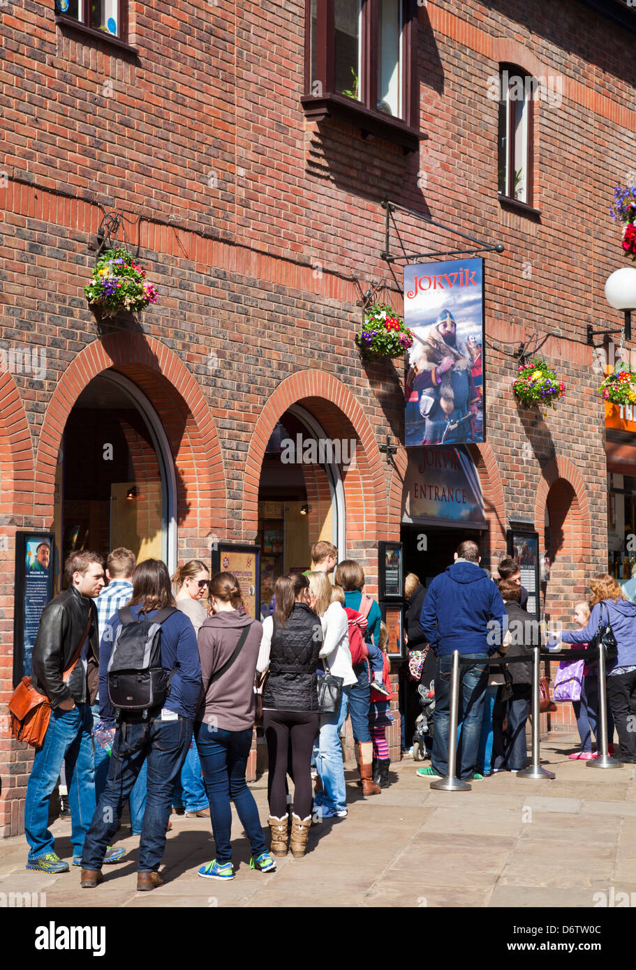 Tourists queuing at  the York Jorvik Viking Centre entrance Coppergate City centre North Yorkshire England UK GB - Stock Image