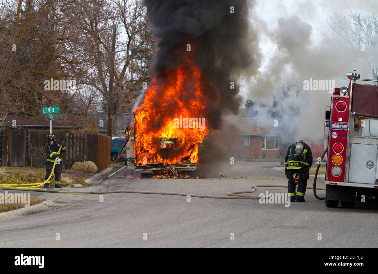 Firefighters putting out a motor home on fire in Boise, Idaho, USA. - Stock Image