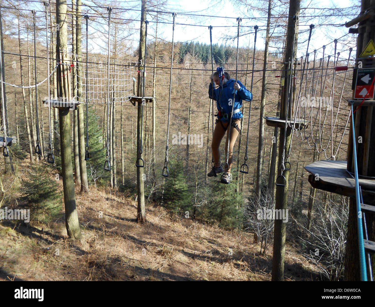 Teenage girl doing Go Ape in Dalby forest. Stock Photo