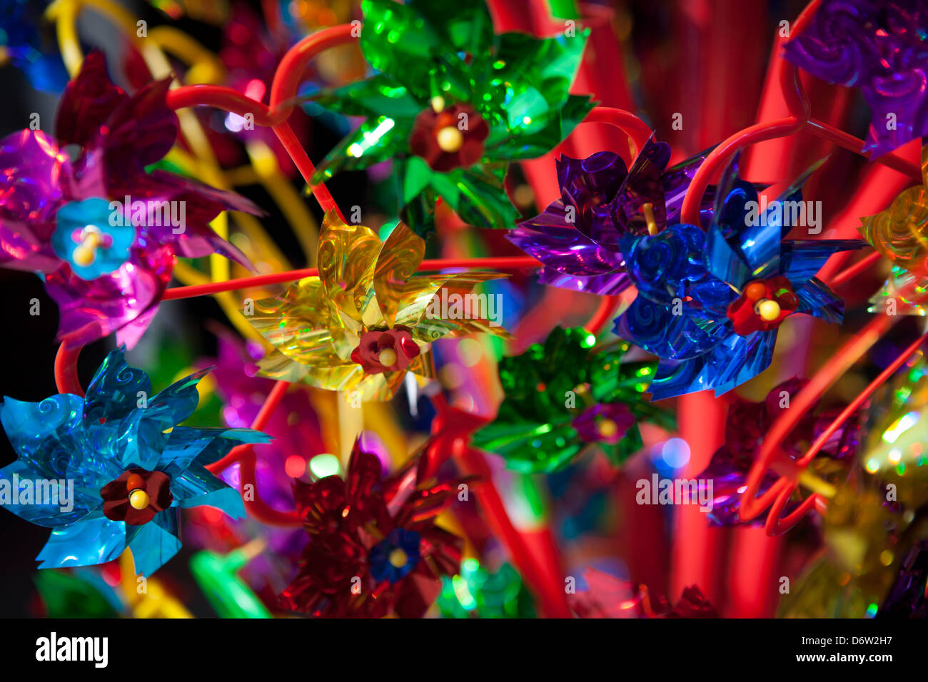 Bright metallic windmill toys at the seaside. - Stock Image